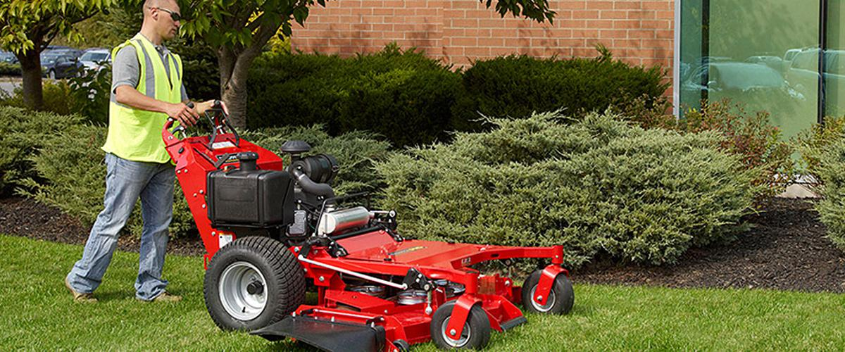 Man using a commercial lawn mower in salt lake city